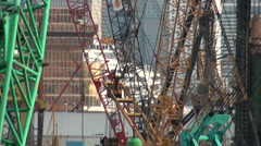 Hong Kong construction, worker 'flying', cranes, building site, engineering Stock Footage
