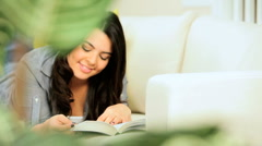 Pretty Young Girl Relaxing With a Book - stock footage