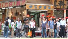 Hong Kong, Kowloon, people cross the street, traffic, pedestrians, road - stock footage