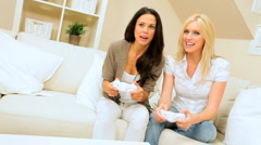 Two Girlfriends Having Fun on Games Console - stock footage