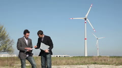 Technician Engineers checking Wind Turbines Parameters Stock Footage