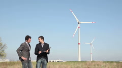 Businessman sign a project for Wind Turbine - stock footage