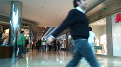 People walking in a shopping mall Stock Footage