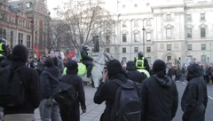 Police on Horseback Scuffle with Protester Stock Footage