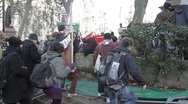 Protesters walk over barriers Stock Footage