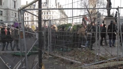 Protesters walk through barricade - stock footage