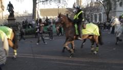 Police on horseback patrol Stock Footage