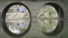Fishing near construction site in China Stock Footage