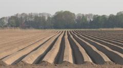 Farmland ready for implantation of potato, river Stock Footage