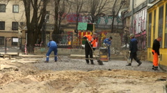 Workers are pavings street Stock Footage