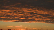 Orange and purple clouds at sunset Stock Footage