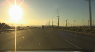 Stock Video Footage of Windmill power generators near Palm Springs vehicle shot  I-10 east bound - 1