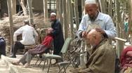 Shaving heads in Layka village Stock Footage