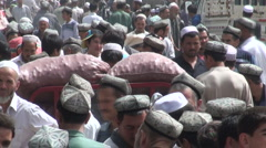 Trading day at farmers market in Xinjiang village, China, Chinese Stock Footage