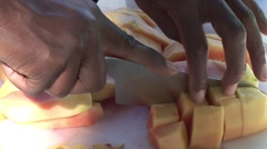 Cutting papaya into chunks Stock Footage