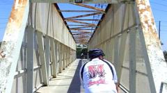 Urban Bike Riding Over Old Bridge 2 Stock Footage