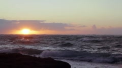 Sunrise over a rough ocean Stock Footage