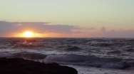 Stock Video Footage of Sunrise over a rough ocean