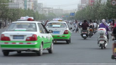 Traffic in Hotan, a major city in Xinjiang in Western China Stock Footage