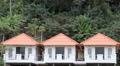 Three Identical Houses in Kata Beach in Phuket Island, Thailand, Palm Tree Footage