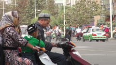 Veiled women on motorbike in Xinjiang editorial Stock Footage