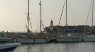 Harbor of Urk, boat passing by Stock Footage