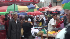 Busy fruit and vegetable market in Hotan in Western China Stock Footage