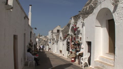 Italy Alberobello with souvenir shop Stock Footage