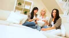 Pretty Girlfriends Watching Scary Movie with Popcorn Stock Footage