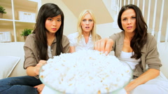 Young Girlfriends Watching Scary Movie with Popcorn Stock Footage