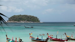 People walking, swimming, snorkeling, Kata Beach in Phuket Island, Thailand - stock footage