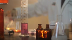 Scientist mixing chemicals Stock Footage