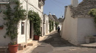 Stock Video Footage of Italy Alberobello old man in street