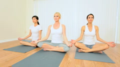 Three Multi-Ethnic Females at Yoga Class Stock Footage