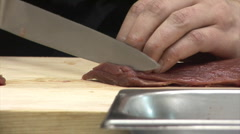 cutting the meat 1 - stock footage