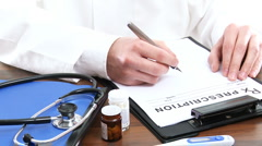 Doctor is writing prescription. - stock footage