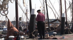 Quay of Urk, fisherman and boats Stock Footage
