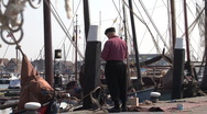 Stock Video Footage of Quay of Urk, fisherman and boats