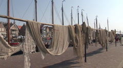Quay of Urk, harbor with fishnets Stock Footage
