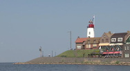 Stock Video Footage of Quay of Urk, lighthouse, IJsselmeer
