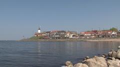 Quay of Urk, lighthouse, IJsselmeer Stock Footage
