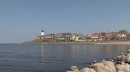 Quay of Urk, lighthouse, IJsselmeer Stock Footage