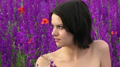 Beautiful girl on the field of lupine Stock Footage