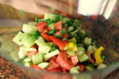 Female hands prepares a mixed salat in a glass bowl Stock Footage