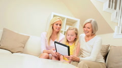 Three Generations Having Fun with Wireless Tablet Stock Footage