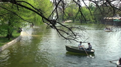 Lake in a park with boats and nature in spring Stock Footage