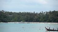 People walking, swimming, snorkeling, Kata Beach in Phuket Island, Thailand Stock Footage