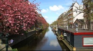 Stock Video Footage of Amsterdam Holland floating house, canals, bridges, buildings, boats