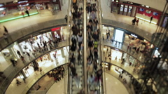 People on an escalator in a mall Stock Footage