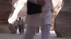 tourists in Siq, Baeytel background - stock footage